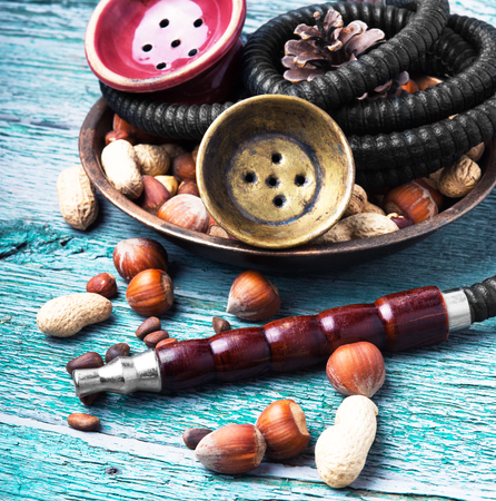inhalation: smoking hookah with a taste of mix nut Stock Photo