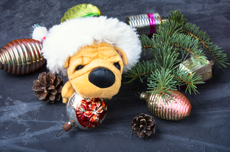 symbolic puppy of dog in Christmas decorations Stock fotó