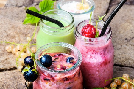 drink smoothies from currant in jar on stone background