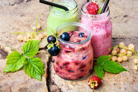 drink smoothies from currant in jar on a stone background