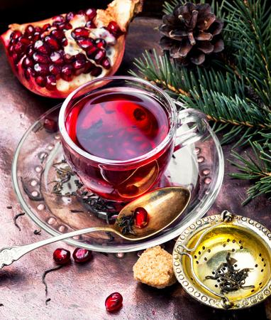 Turkish winter tasty tea with pomegranate seeds.Fruit tea Stock Photo