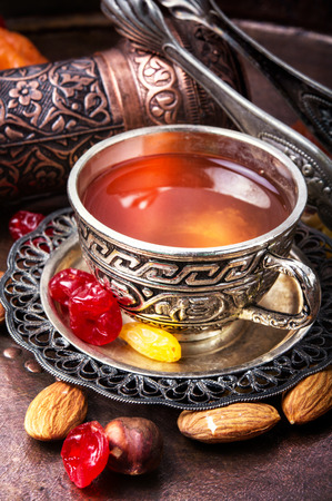 Arabic tea with nuts and oriental sweets.Tea still life