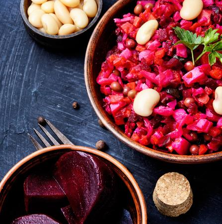 Traditional vegetarian russian beetroot salad vinaigrette on slate background
