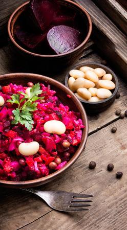 Traditional vegetarian russian beetroot salad vinaigrette in rustic recipe Stock Photo