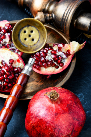 Exotic smoking shisha in east style with tobacco aroma of pomegranate.Fruit hookah
