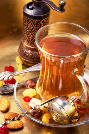 turk tea with nuts and oriental sweets.Tea still life Stock Photo