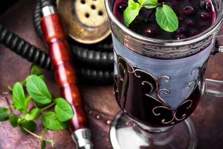 Arabic hookah with a taste of berry alcoholic beverage