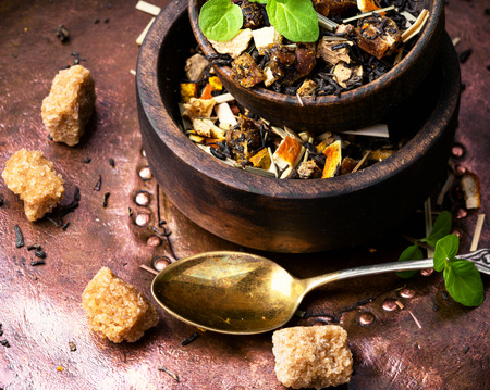 mix of fruit tea leaf in a wooden bowl Stock Photo