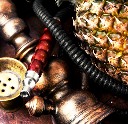 Stylish hookah with the aroma pineapple for relax.Pineapple shisha.Concept shisha Stock Photo