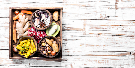 Healthy eating food concept with nut, spice, vegetables and fruit