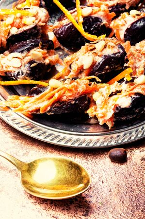Traditional Russian dessert prunes stuffed with nuts