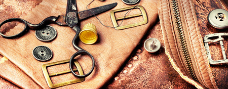 Working tools and cut out pieces of leather Stock Photo