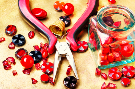 Beads, colorful beads and tools for needlework. Stock Photo