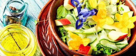 Vegetarian salad leaves with herbs and flowers.Healthy food