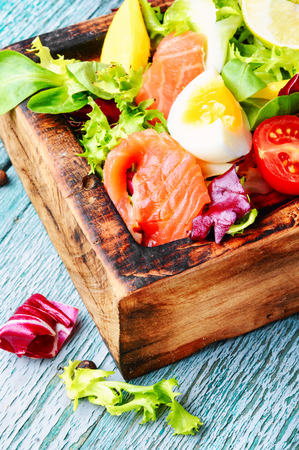 Diet salad with salmon,mango and fresh lettuce.Fish salad Stock Photo