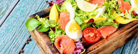 Diet salad with salmon,mango and fresh lettuce Stock Photo