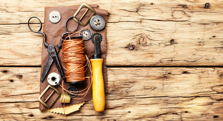 Working tools and cut out pieces of leather Stockfoto