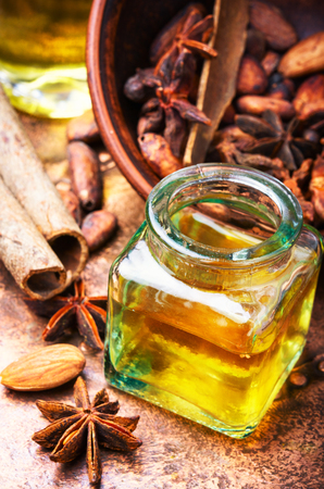 Essential oil with cinnamon and anise in bottle Banco de Imagens