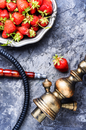 Oriental hookah with the aroma strawberry for relax.Strawberry shisha Archivio Fotografico