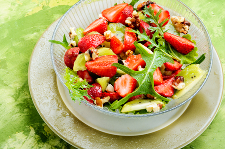 dietary summer salad with strawberries, fruits and lettuce