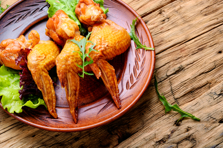 Smoked chicken wings and leaf salad. Fast food Stock Photo - 103619393