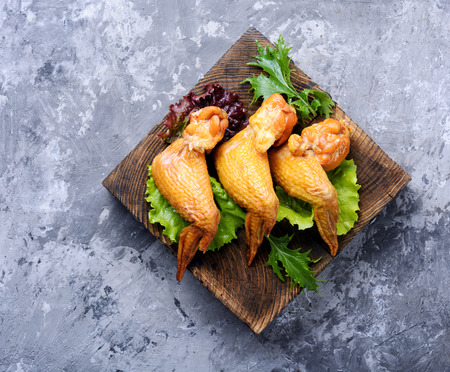 Smoked chicken wings and leaf salad. Fast food