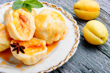 Fruit dumplings with apricot and spicy syrup Stock Photo