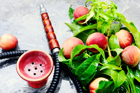 Hookah for smoking with the aroma peach.Peach shisha Stock Photo