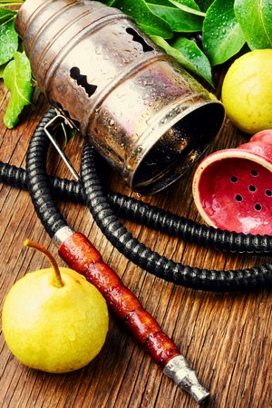 Hookah for smoking with the aroma pear.Pear shisha