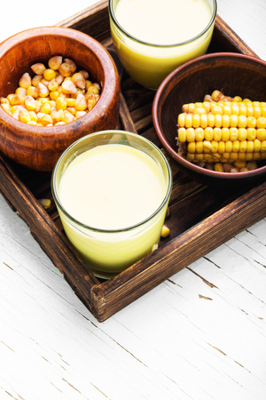 Fresh sweet corn juice in glass.Corn milk.