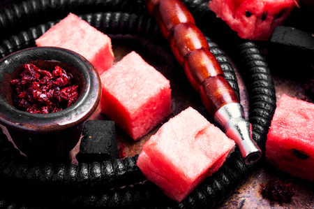 Fashionable fruit smoking hookah with a tobacco flavor of watermelon.Eastern shisha
