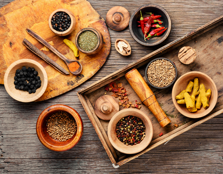 Big set Indian spices and herbs.Food and cuisine ingredients.Spices on a wooden board Stock fotó