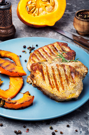 Baked meat with pumpkin on plate.Steak with pumpkin