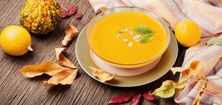 Pumpkin soup on rustic wooden background.Autumnal pumpkin soup Stock Photo