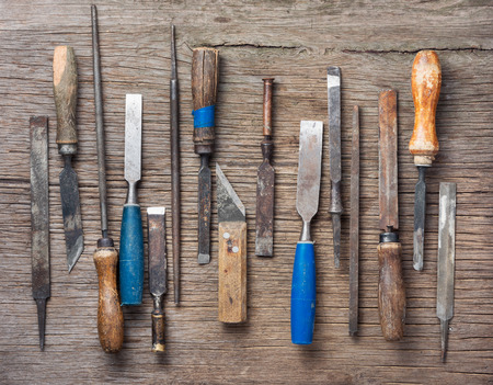 Old vintage hand tools on wooden background.Collection of vintage tools