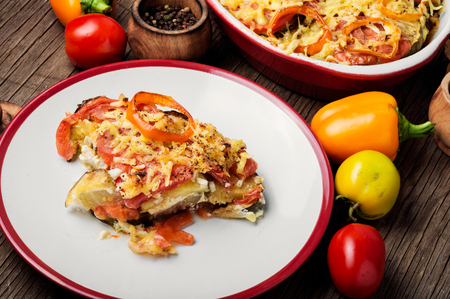 Stewed, baked zucchini, tomatoes and peppers.Traditional French vegetable dish