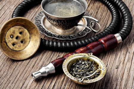 Turkish shisha hookah with aroma tea for relax.Shisha and tea Фото со стока