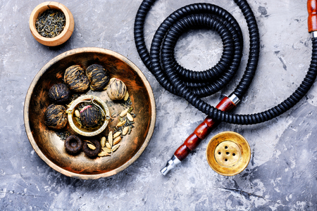 Turkish shisha hookah with aroma tea for relax.Shisha and tea Imagens