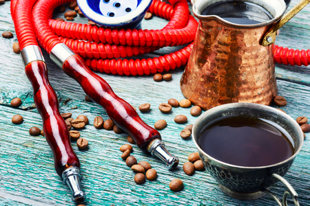 Oriental shisha hookah with aroma coffee for relax.Arabian shisha and coffee.Oriental ornament.Shisha Concept