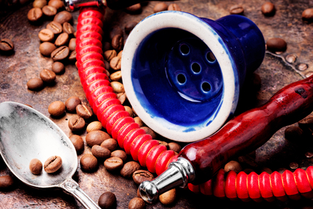 Oriental shisha hookah with aroma coffee for relax.Modern hookah with coffee.Traditional arabic shisha Imagens