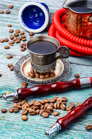 Stylish Turkish hookah for two mouthpieces and a cup of coffee. 스톡 콘텐츠