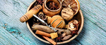 Ingredients for traditional drink on winter holiday.Winter drink mulled wine