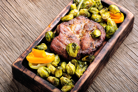 Grilled meat barbecue steak with brussels sprouts.Grilled meat and vegetable garnish Stok Fotoğraf