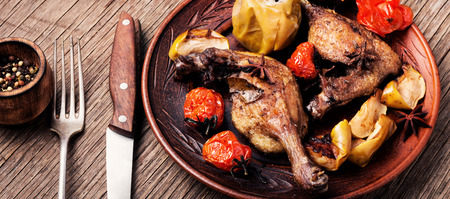 Appetizing roasted duck leg with apples and vegetables. Dietary meat 写真素材