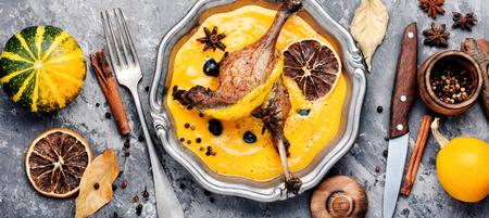 Appetizing roasted duck leg in pumpkin puree.Duck meat. Italian food