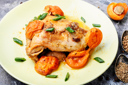 Chicken breast stewed in apricot sauce.Baked chicken meat