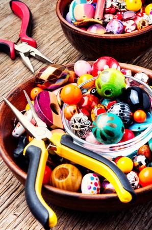 Jewelry making and beading process.Set colored beads.Creativity.Handmade