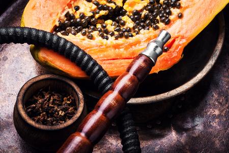 Fashionable fruit smoking hookah with a tobacco flavor of papaya.Eastern shisha.Smoking hookah.