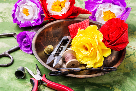 Colourful handmade paper flowers.Paper craft and tools.Hobby