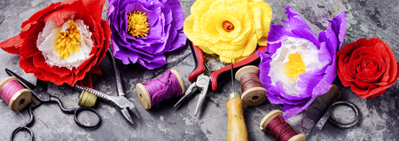 Colourful handmade paper flowers.Paper craft and tools